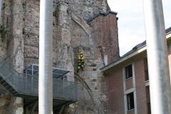 Sint-Truiden-141-Restaurateur-aan-het-werk-bij-Abdijtoren
